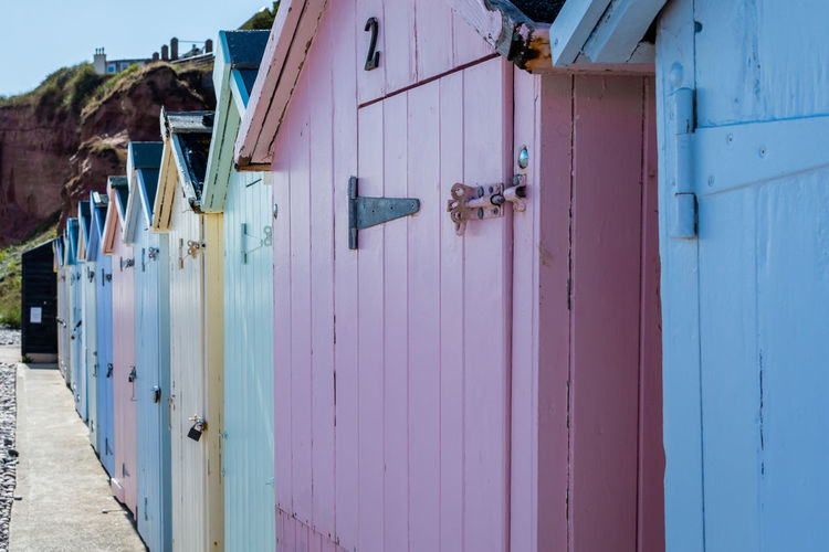Architecture Beach Hut Building Building Exterior Built Structure Closed Day Door Entrance Focus On Foreground House Multi Colored Nature No People Outdoors Pink Color Protection Residential District Safety Security Wood - Material