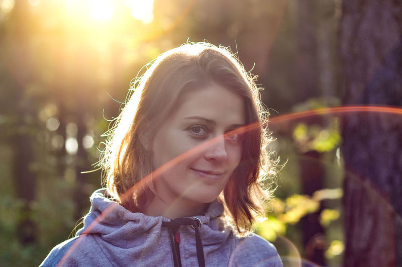 Beautiful Woman Day Emotion Females Focus On Foreground Front View Hairstyle Happiness Headshot Leisure Activity Lens Flare Lifestyles Looking At Camera Nature One Person Outdoors Portrait Real People Smiling Sunlight Women Young Adult The Portraitist - 2019 EyeEm Awards The Traveler - 2019 EyeEm Awards