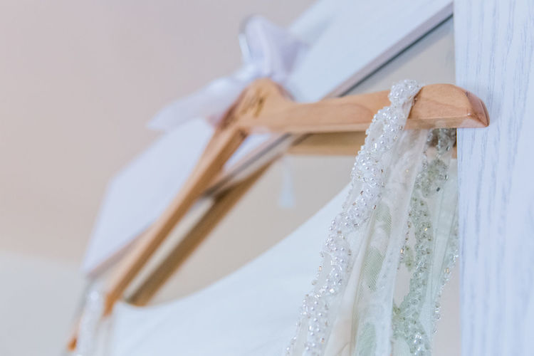 Celebration Close-up Clothing Coathanger Dress Elégance Event Fashion Focus On Foreground Hanging Indoors  Life Events No People Still Life Textile Wall - Building Feature Wedding Wedding Dress White Color Wood - Material