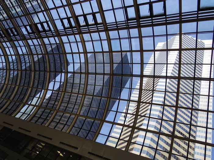 Glass - Material Architecture Built Structure Modern Window Indoors  Low Angle View Skyscraper City No People Day Sky Office Buildings
