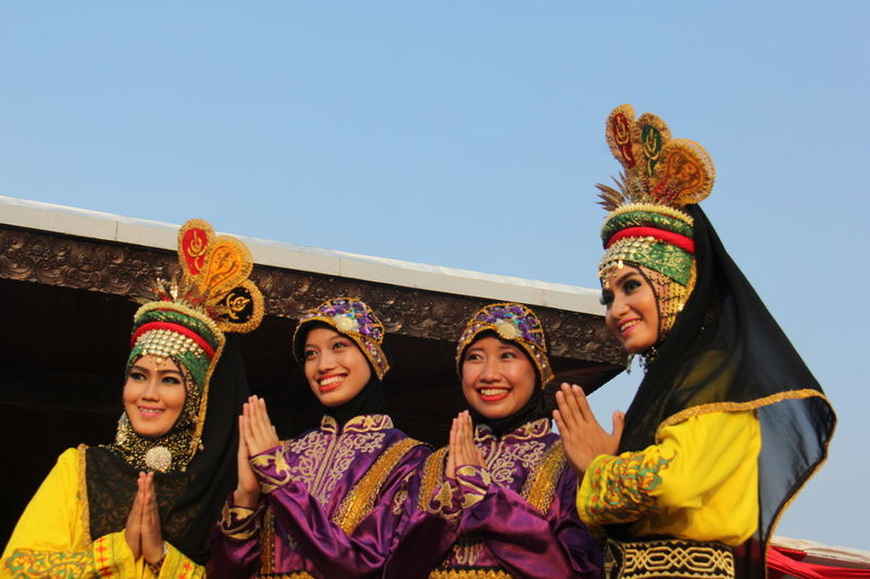 They are dancers from Aceh Province, Indonesia who was came to capital for danced with 6.600 dancers in Taman Mini Indonesia Indah, Jakarta. Aceh, Indonesia Asian Girl Casual Clothing Culture Dancers Enjoyment Front View Fun Happiness INDONESIA Indonesian Culture Leisure Activity Lifestyles Outdoors Portrait Smiling Tradional Dancing Traditional Clothing Traditional Culture Traditional Dancer