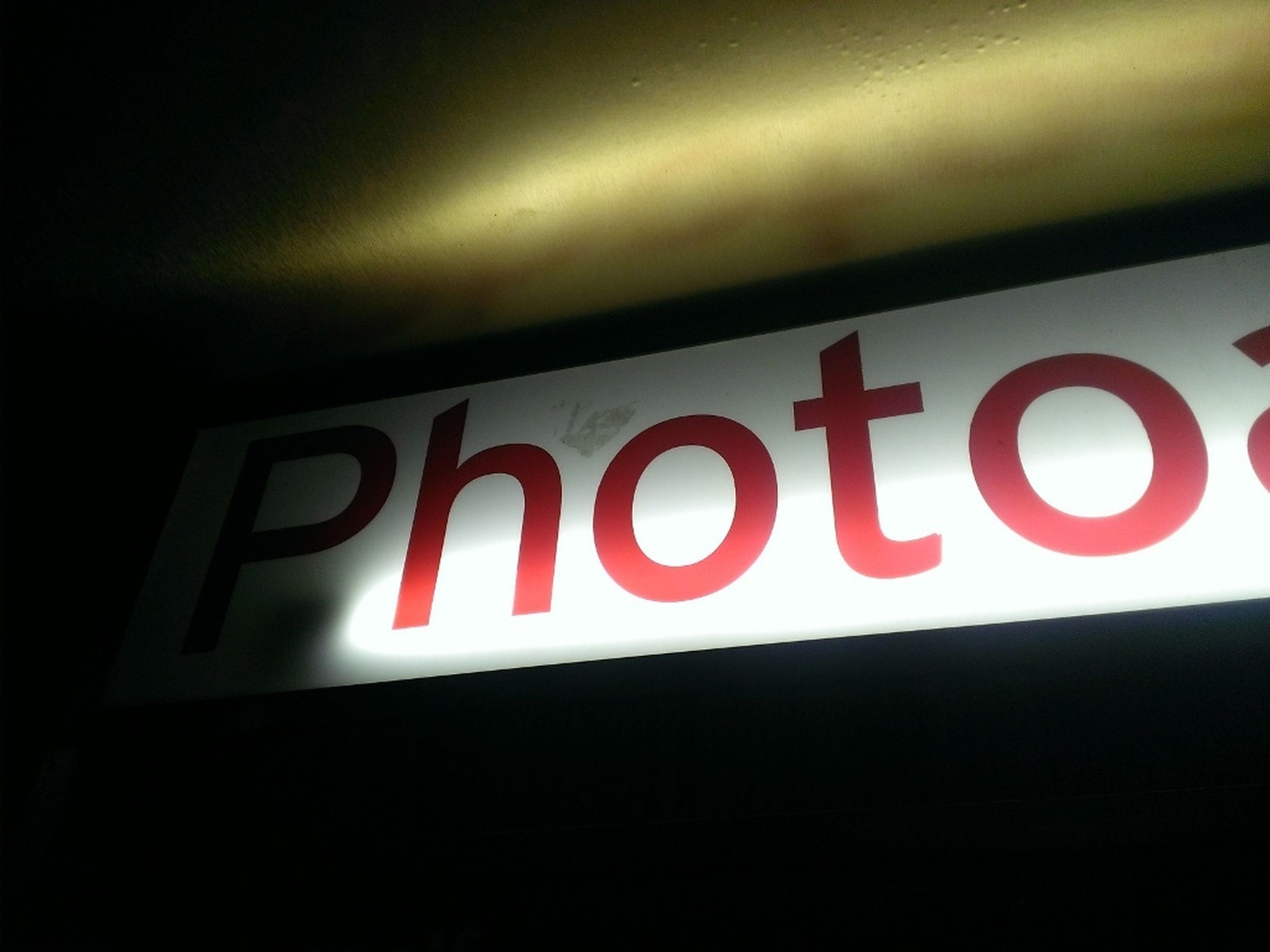 text, communication, western script, red, illuminated, capital letter, indoors, sign, night, information sign, close-up, guidance, wall - building feature, no people, neon, information, built structure, low angle view, architecture, copy space
