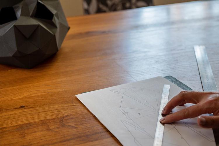 High angle view of human hand on table