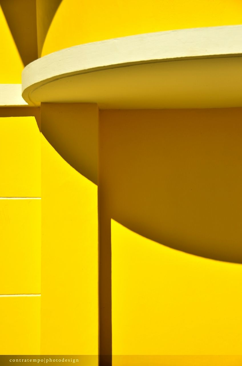 CLOSE UP OF YELLOW STRUCTURE