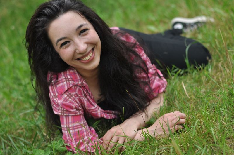 Portrait of smiling young woman in grass