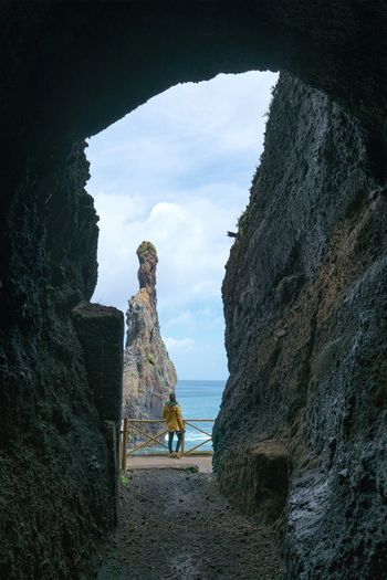 Girl looking at Ribeira da Janela islet between a cave in Madeira Madeira Portugal Island Ilha Landscape Nature Islet Ribeira Da Janela Seascape Panorama Panoramic Rock Outdoors Sea Ocean Atlantic Woman Portrait Travel Traveler Portuguese Best  Alone Porto Moniz Ilheu