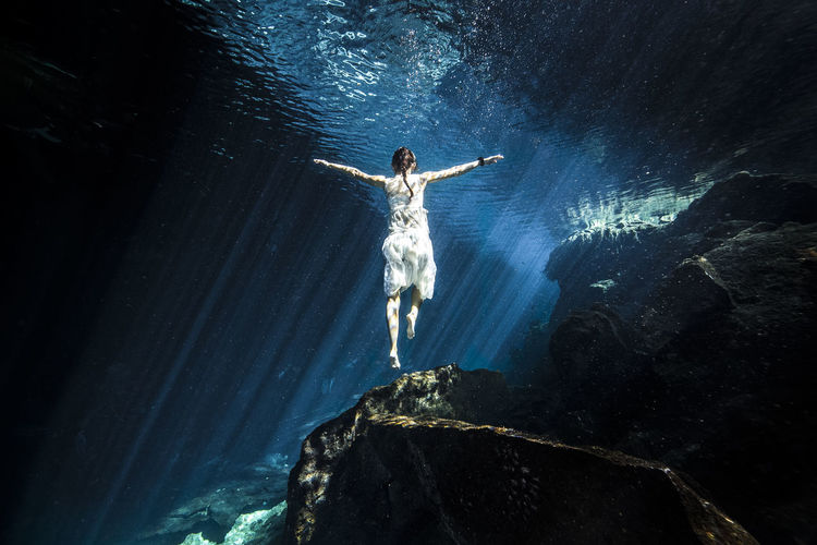 Adventure Beauty In Nature Freedom Girl Lights One Person Portrait Sun Beams Sunbeam Sunlight Underwater White Skirt