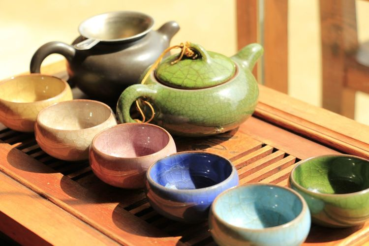 Ceramics Teapot And Bowls On Table