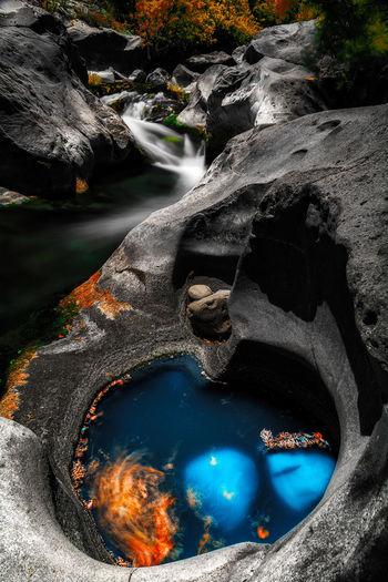 Beauty In Nature Day Environment Flowing Flowing Water Geology High Angle View Long Exposure Motion Nature No People Non-urban Scene Outdoors Power In Nature Purity Rock Rock - Object Scenics - Nature Solid Travel Destinations Water Waterfall