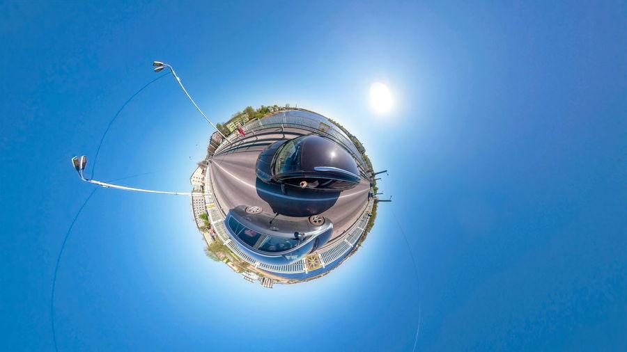 Digital composite image of ferris wheel against blue sky