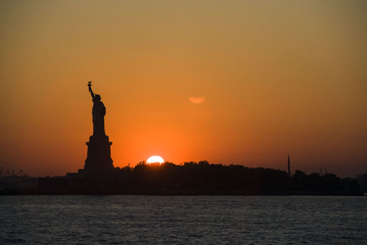 Statue of liberty against sky during sunset