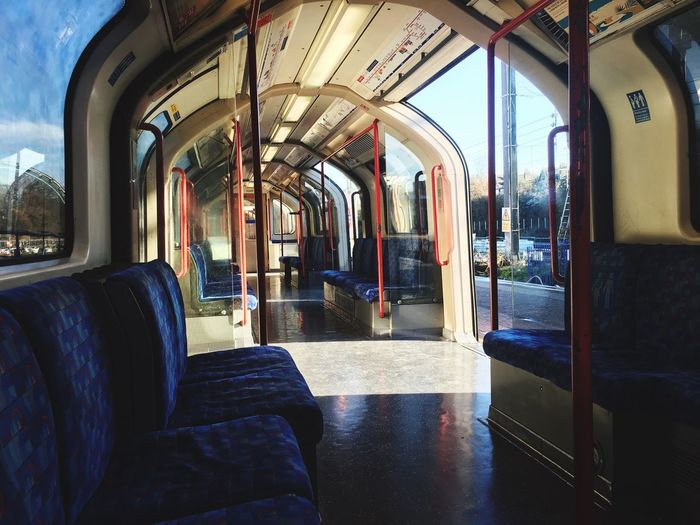 Alone Vehicle Interior Window Transportation Mode Of Transport Public Transportation Vehicle Seat Train - Vehicle Travel Journey Indoors  Day Seat Rail Transportation Sunlight Architectural Column Real People Sky London London Underground Ealing Broadway Ealing Alone The Street Photographer - 2017 EyeEm Awards BYOPaper!