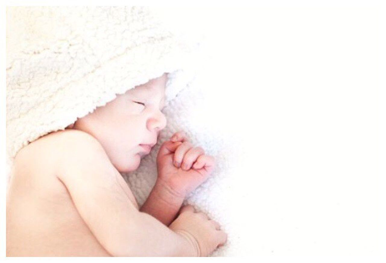 sleeping, eyes closed, people, relaxation, lying down, human body part, one person, childhood, cute, indoors, fragility, comfortable, child, adult, day, bedroom, close-up, human hand, babies only, young adult