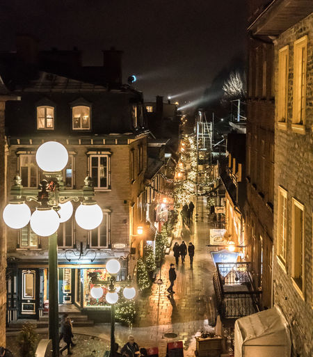 Christmas Cobblestone Streets Lamp Post Looking Down Nightphotography Old Quebec City Shopping Strolling Tourist Attraction  Winter Above Architecture Building Exterior Built Structure Decorations Destination Evening History Illuminated Night Outdoors People Sky Street Windows Holiday Moments
