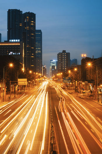 night cars traffic in chengdu Architecture Building Exterior City Illuminated Built Structure Long Exposure Street Motion Road Transportation Light Trail Night Office Building Exterior Speed Sky City Life Blurred Motion Street Light Building Traffic Cityscape Skyscraper No People City Street Outdoors