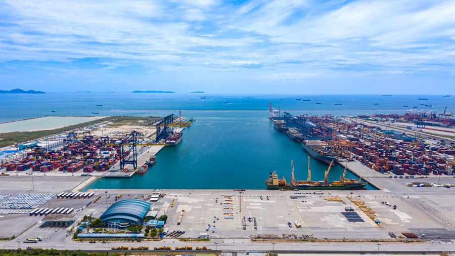 Shipping port logistics cargo transportation import export international open sea aerial view