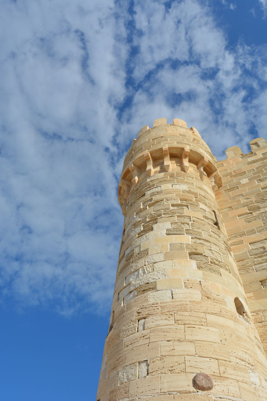 low angle view, built structure, architecture, building exterior, sky, cloud - sky, tower, history, building, the past, no people, day, travel, nature, travel destinations, tourism, tall - high, outdoors, wall, ancient, stone wall, ancient civilization