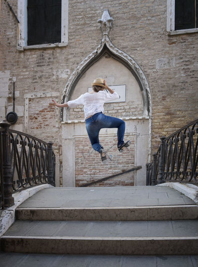 Dancer on venice canal steps