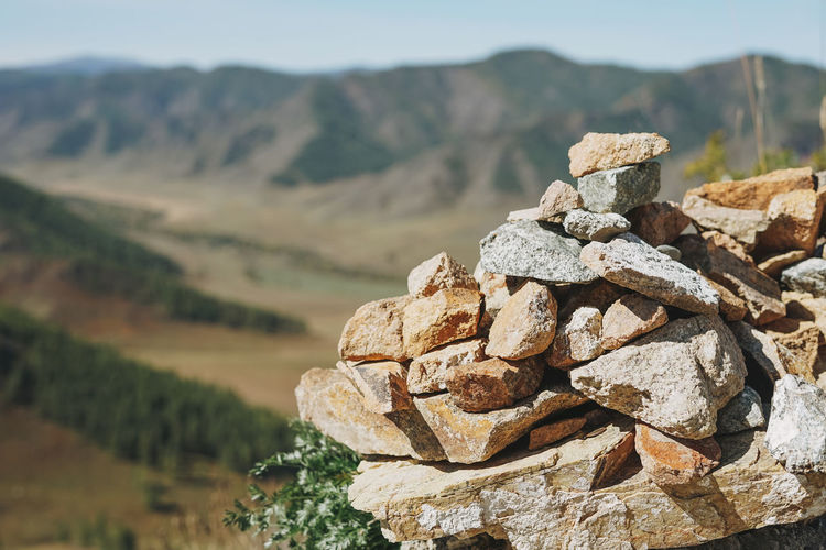Pile of stones pyramid on background of the altai mountains