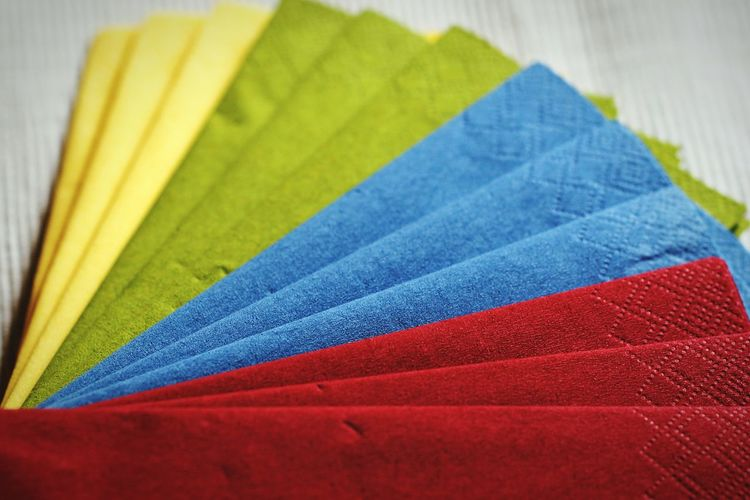 Close-up of multi colored napkins on table