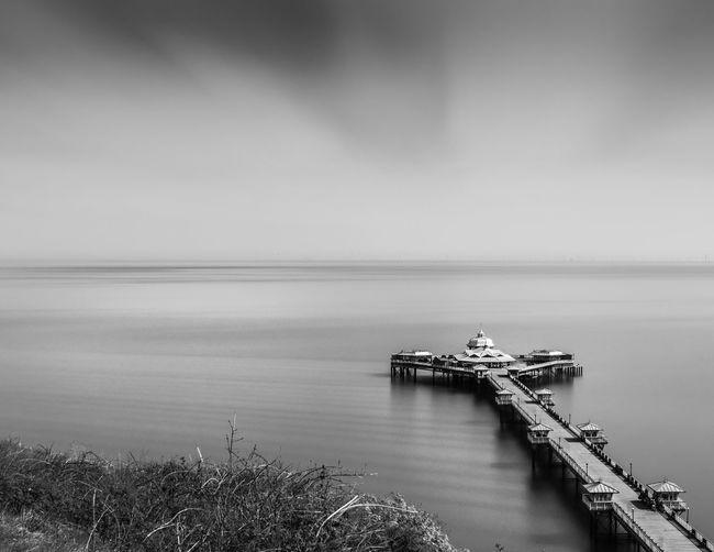Narrow Jetty Leading To Calm Sea