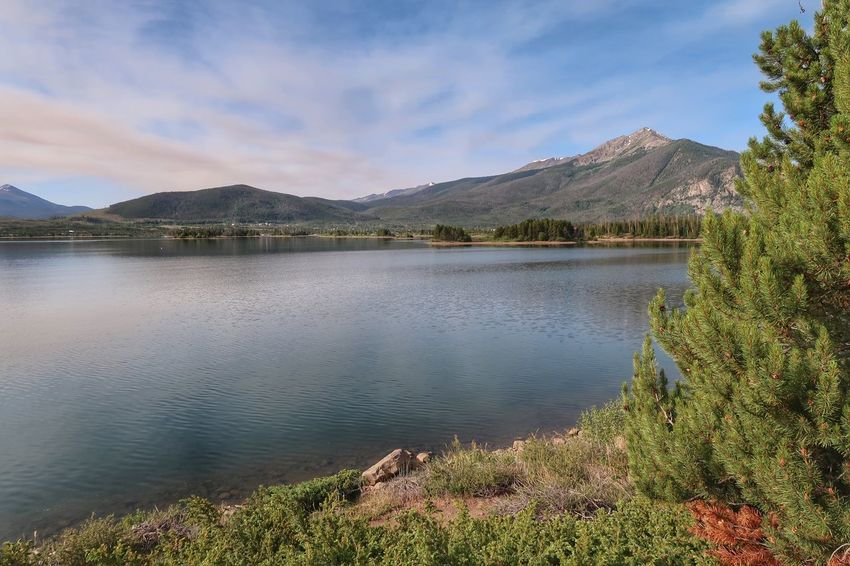 Landscape of a lake in Colorado with mountains in the background Dillon Reservoir Colorado Mountain Sky Cloud - Sky Water Beauty In Nature Scenics - Nature Plant Tranquil Scene Nature Day Mountain Range No People Tree Growth Non-urban Scene Outdoors Travel Destinations Mountain Peak Tranquility Lake