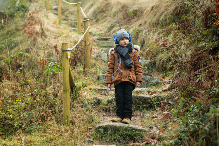 Little boy Boy Beauty In Nature Day Front View Grass Holding Nature Warm Clothing Little Boy Son Outdoors People Plant Rural Scene Winter Family Boy Camera Bühlertal