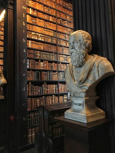 Sokrates, old books, history, sculpture IPhoneography EyeEmNewHere Old Library Trinity College Library Old Books Sculpture Sócrates Statue Bookshelf Human Representation Library Male Likeness Sculpture Indoors  Literature Spirituality No People Day Shelf
