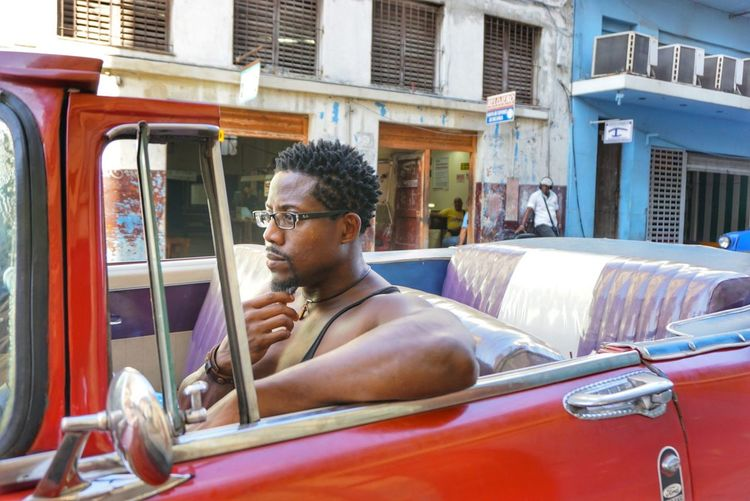 One Person Transportation Car Outdoors Eyeglasses  Real People Travel Destinations Streets Of Cuba Fotogeniksyl Traveling Photography Colors Of Life Cuban Style Lifestyles Confidence  Portrait Street Vintage Convertible Car Vintage Cars Classic Car Transportation Close-up