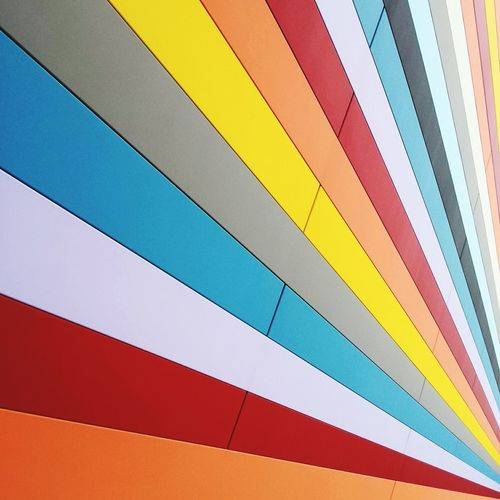Low angle view of multi colored paper