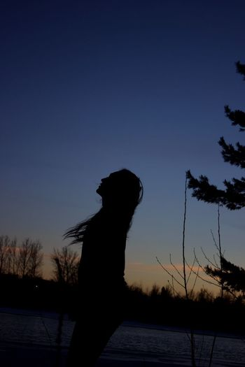 Silhouette Sunset One Person Real People Nature Lifestyles Tree Sky Blue Leisure Activity Outdoors Clear Sky Water Beauty In Nature Day Mammal People Sherbrooke