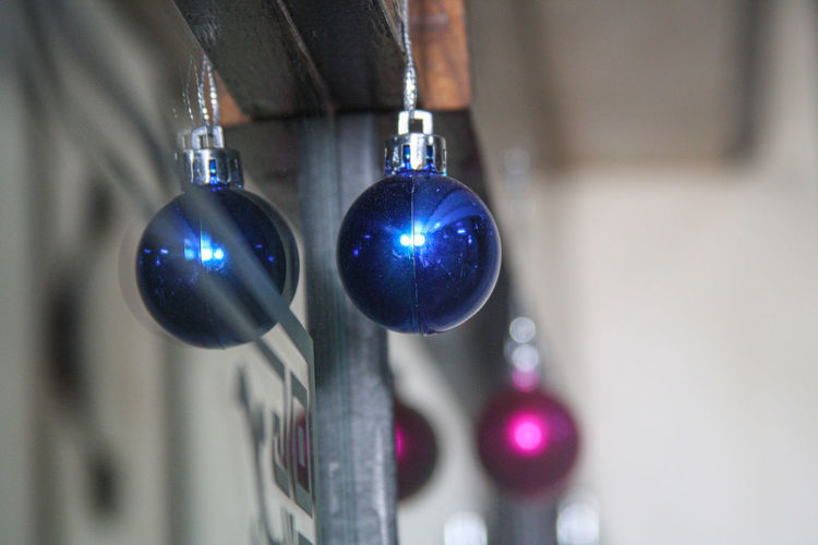 Close-up of multi colored lights hanging on metal