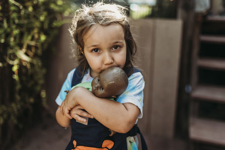 Portrait of cute girl holding toy