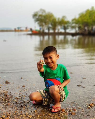 A boy enjoy summer at the seaside Smiling Boy Asian Children Thai Children Asian Boy Thai Boy Thailand Playing Boy Beach Sea Summer Enjoy Shell Seaside Children Only Child One Person Childhood Water One Boy Only Males  Lake Full Length People Sitting Outdoors Nature EyeEmNewHere Real People Portrait Love Yourself This Is Masculinity