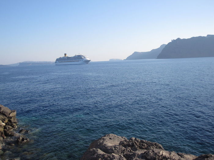 Scenic View Of Cruise Ship In Sea Against Sky
