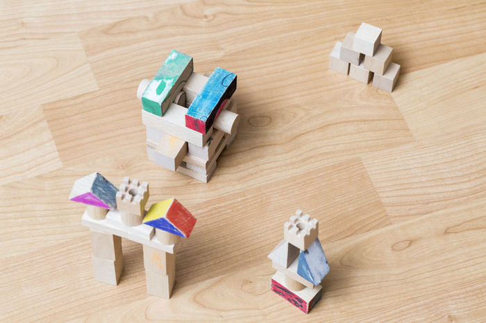 Bird eye view of wooden toys. Construction Construction Site Objects Brown Childhood Cubes Deftness Directly Above Hardwood Floor High Angle View Indoors  Large Group Of Objects Toy Wood - Material Wooden Toys