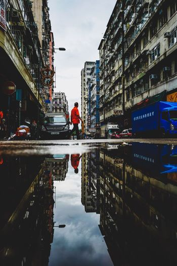 Puddle Reflection Reframinghk Street Photography Discoverhongkong Building Exterior Architecture Built Structure Reflection Water City Sky Transportation Nature Building Puddle Mode Of Transportation Real People Street Incidental People Day Outdoors Car Motor Vehicle Land Vehicle