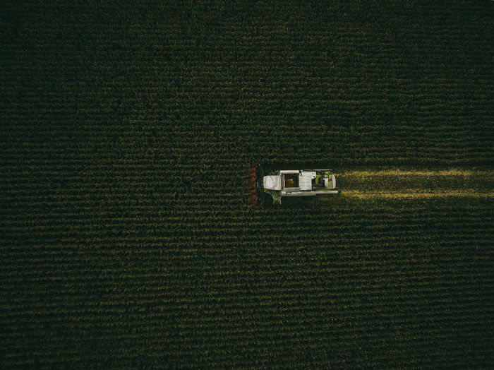 Aerial view of machinery working in agricultural field