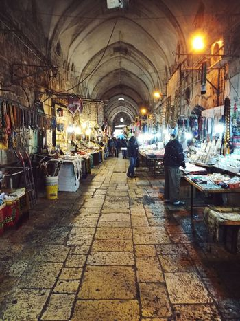 Trading Traditional Culture Urban Lifestyle Urban Life Working People Lifestyles Souk Jerusalem Old City Old City Jerusalem Oriental Style Middle East Bazaar Travel Photography Men Arch Women Walking Architecture Ceiling Bazaar Pendant Light