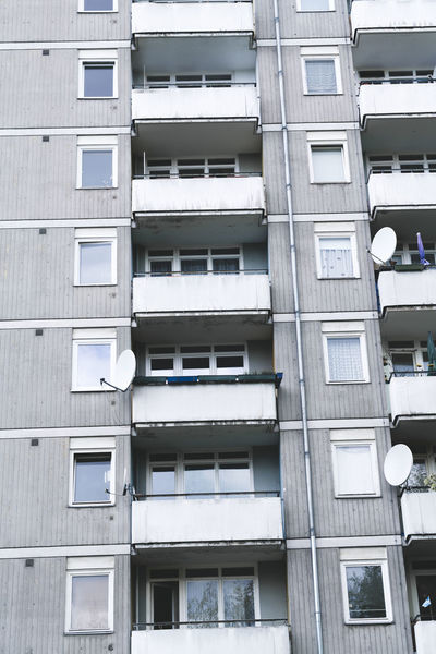 Apartment Architecture Balcony Berlin Building Built Structure City Exterior Façade Flat Full Frame Gentrification Living No People Opposites Outdoors Poor  Public Housing Satellite Dish Social Issues Sparse Urban Window