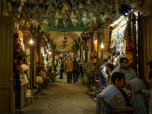 Aleppo Basar 2008 Aleppo_syria Architecture Basar Diminishing Perspective Electric Light Illuminated Indoors  Large Group Of People Leisure Activity Lifestyles Lighting Equipment Men Person Restaurant Suk Al-Madina