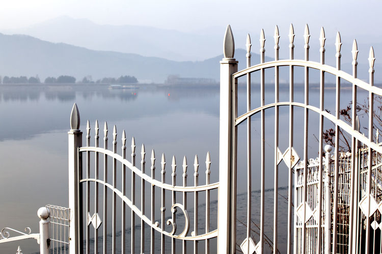 Architecture Building Exterior Built Structure Connection Day Development Engineering Fence Footpath Gate Gongjicheon House In A Row International Landmark Lakescape Modern Narrow Railing Sidewalk Symmetry The Way Forward Tree Walkway