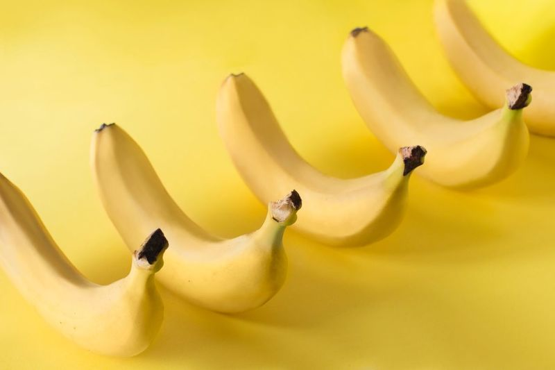 Bananas in a row on yellow background Individuality Creativity Dieting Organic Healthy Eating Healthy Food Vitamin Vegan Food Raw Food Tropical Sweet Food Design Minimalism One Color Monochromatic Monocrome Summertime Symmetrical Simple Yellow Freshness Yellow Background Close-up Banana The Minimalist - 2019 EyeEm Awards The Foodie - 2019 EyeEm Awards