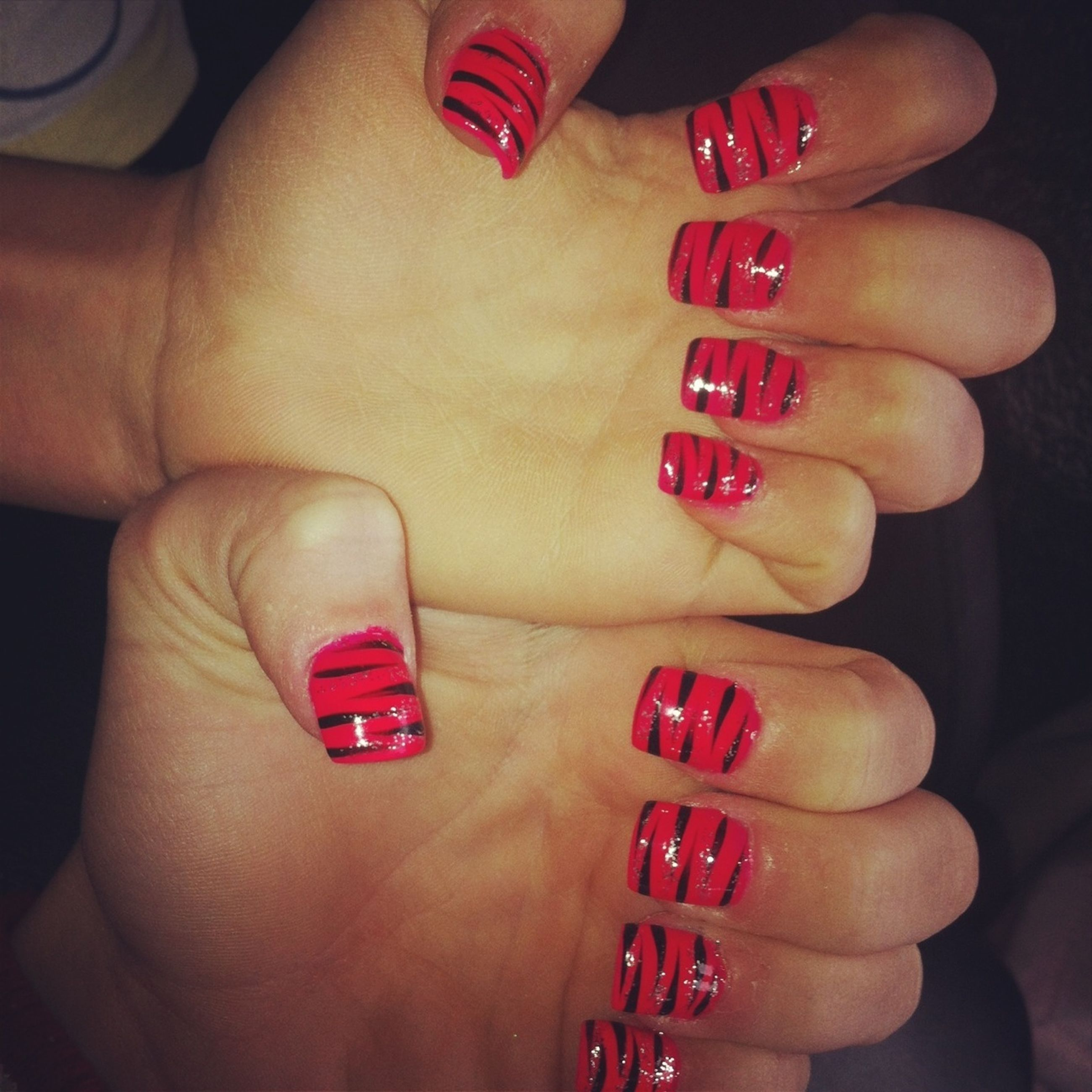 person, text, communication, part of, indoors, holding, human finger, western script, close-up, lifestyles, nail polish, cropped, love, red, leisure activity, ring