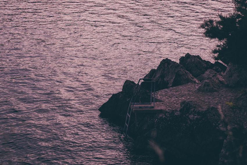 Baska Beauty In Nature Croatia Dark Sea Dark Water Darkness And Light Day Idyllic Idyllic Scenery Krk  Krk Island Kroatien Lovely Place Mood Nature No People Outdoors Rock Rock - Object Rock Formation Rocks Rocks And Water Steps Steps Into Water Water