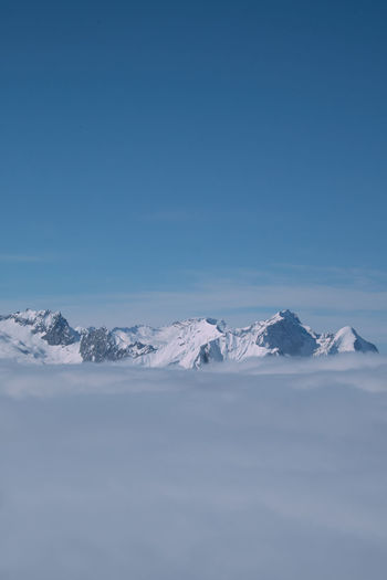 Peaks above the fog. Snow ❄ Winter Beauty In Nature Blue Clear Sky Clouds Clouds And Sky Cold Temperature Day Frozen Landscape Mountain Mountain Range Nature No People Outdoors Peaks Scenics Sky Snow Snow Covered Snowcapped Mountain Tranquil Scene Tranquility Winter