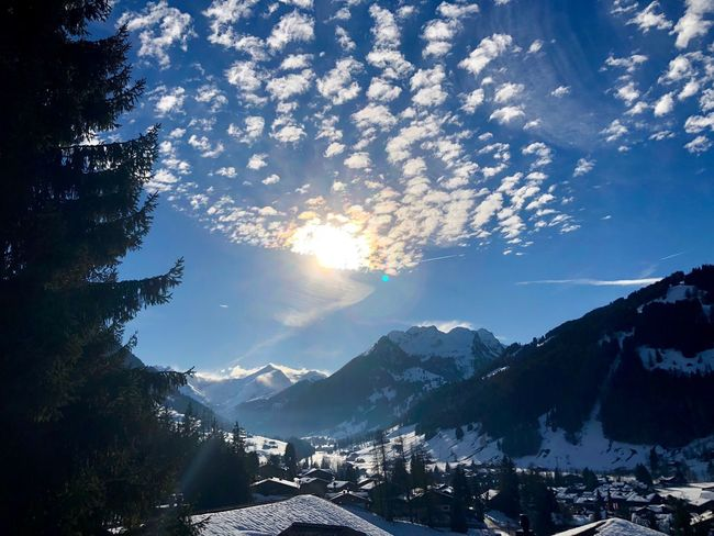 Spotty sky GstaadPalace I❤️Gstaad Bolonie Style Bolonie Art Bolonie Snow Mountain Winter Cold Temperature Nature Beauty In Nature Scenics Tranquil Scene Sunlight Sky No People Outdoors Tranquility Mountain Range Cloud - Sky Day Tree Building Exterior