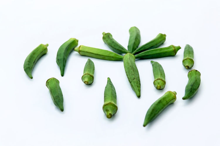 High angle view of chopped vegetables against white background
