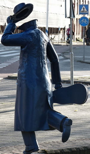 City Life EyeEmNewHere Hello City Goodbye Outdoors Passer-by Sculpture In The City Strange Street To Doff One's Hat Violin Case Without Head Your Ticket To Europe The Week On EyeEm The Street Photographer - 2018 EyeEm Awards