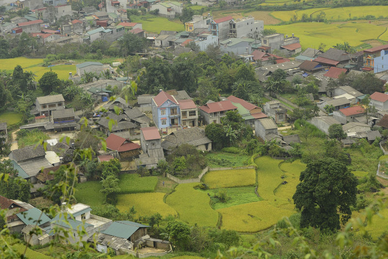 Beautiful View of Quan Ba town in Ha Giang district during cloudy and foggy morning. Witness of the twin mountain . The road is the gateway to the Dong Van Karst Plateau Geopark Quản Bạ World Heritage Site By UNESCO Unesco Landscape Geopark Town Paddy Fields Building Architecture Building Exterior Built Structure House Plant Tree Residential District Environment Nature No People Day Scenics - Nature Beauty In Nature Rural Scene Outdoors Green Color Patchwork Landscape High Angle View Housing Development